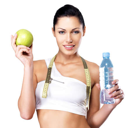 woman healthy: Portrait of a healthy woman with apple and bottle of water. Healthy fitness and eating lifestyle concept.  Stock Photo