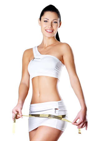 slim woman: Smiling healthy woman after dieting measures hip. Healthy lifestyle. Stock Photo