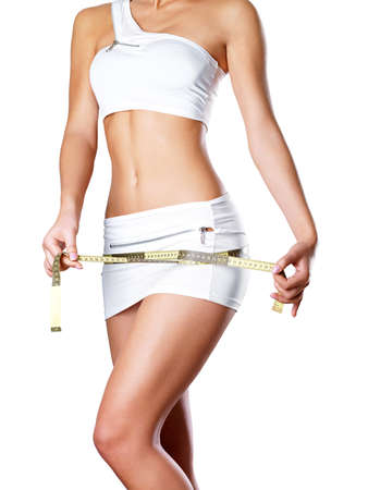 perfect: Girl measures thigh with a measuring type. Healthy lifestyle cocnept. Stock Photo