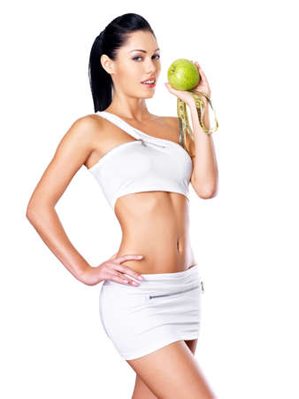 Portrait of a healthy woman with apple and bottle of water. Healthy fitness and eating lifestyle concept.  Stock Photo