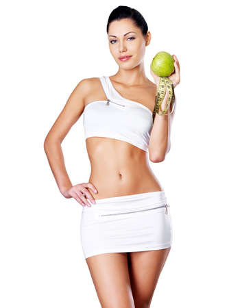 Healthy girl with apple and measuring tape. Healthy lifestyle cocnept. photo