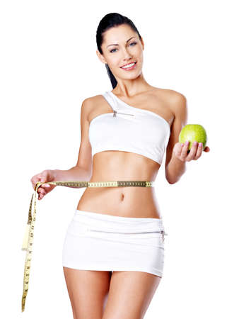 Slimming woman with a measuring tape and apple. Healthy lifestyle for female. Stock Photo