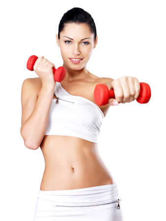 Photo of a healthy training young woman with dumbbells.  Healthy lifestyle concept. photo