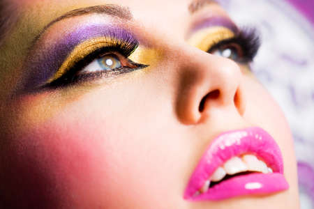Closeup face of beautiful woman with fashion bright makeup photo