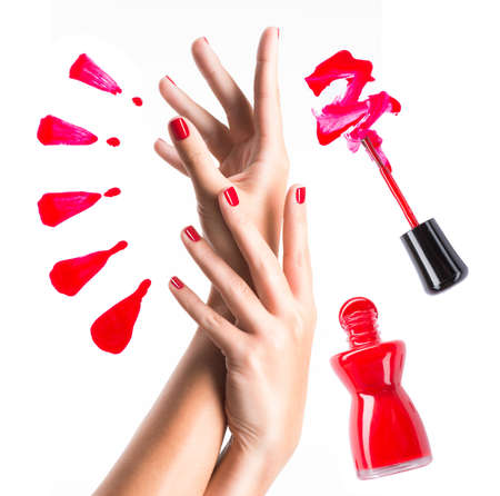 Beautiful female hands with red manicure and  nail polish  bottle with  brush Stock Photo - 22059512