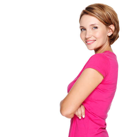 smiling girls: Portrait of a beautiful young adult white happy woman over white background wearing pink shirt Stock Photo