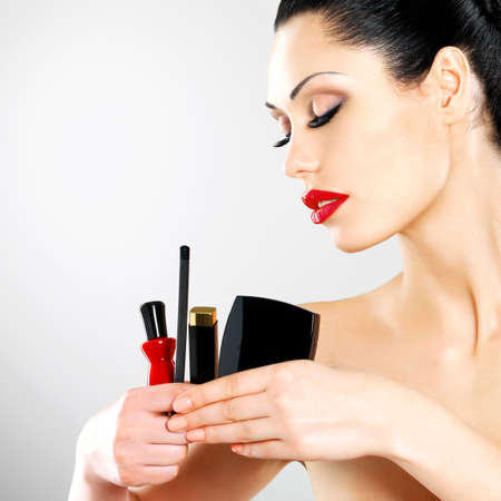 Beautiful woman with makeup cosmetic tools near her face.  Stock Photo - 22132266