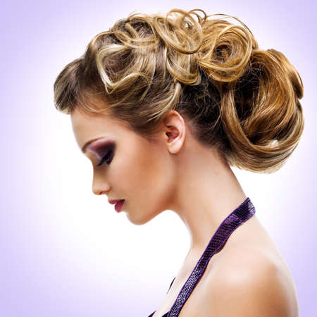 Profile portrait of  woman with fashion  hairstyle over creative background photo