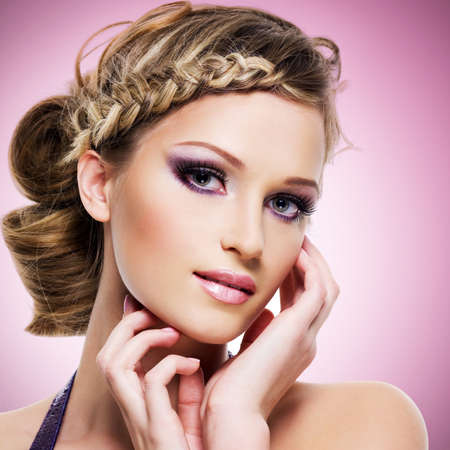 Beautiful woman with fashion hairstyle and pink makeup photo