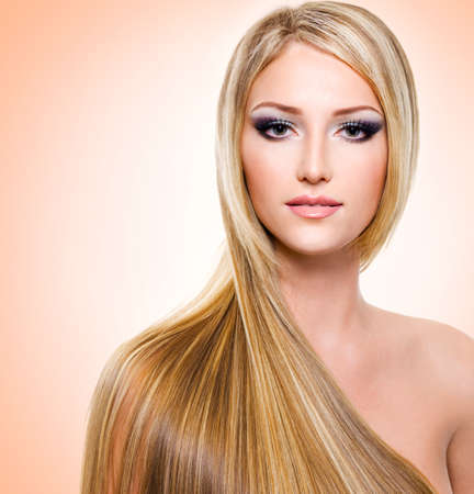 Beautiful woman with long straight white hair photo