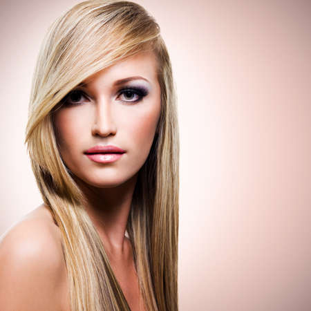 Portrait of beautiful woman with long straight white hair looking at camera  photo