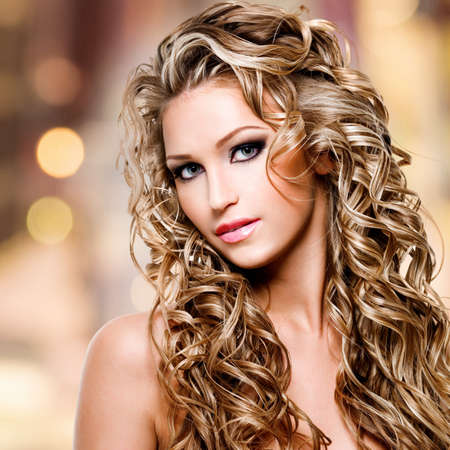 Beautiful woman with long curly hairstyle photo