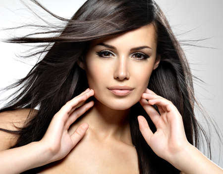 Fashion model  with beauty long straight hair.  Creative studio image. Stock Photo - 22359145