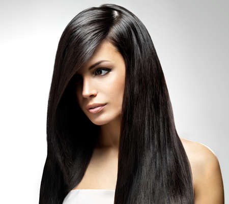 black hair: Beautiful woman with long straight hair. Fashion model posing at studio.