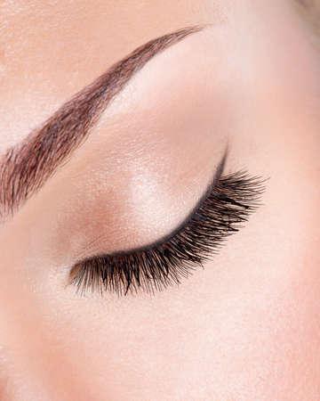 closed eye: macro image of  long curly eyelashes