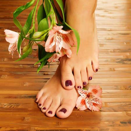 spa pedicure: Closeup photo of a female feet at spa salon on pedicure procedure - Soft focus image