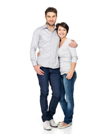 standing: Full portrait of happy couple isolated on white background. Attractive man and woman being playful.