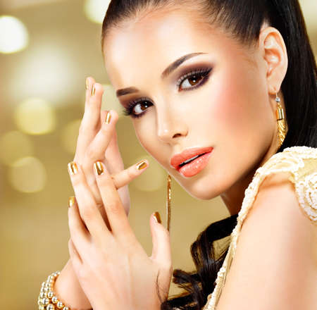 jewelry model: Closeup beautiful face of glamor woman with black eye makeup