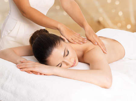 woman spa: Woman having massage of body in the spa salon. Beauty treatment concept.