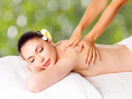 back massage: Woman having massage of body in the spa salon. Beauty treatment concept.