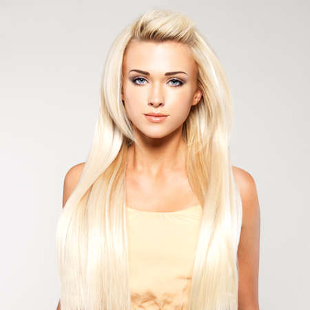 beautiful lady: Beautiful woman with long straight blond hair. Fashion model posing at studio.