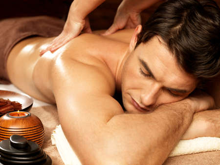 spa therapy: Masseur massaging man in the spa salon. Beauty treatment concept.