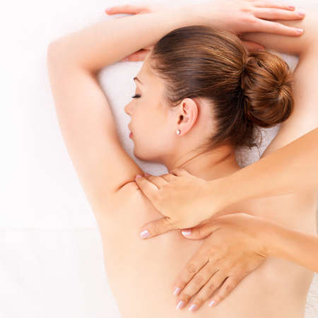 pamper: Woman having massage of body in the spa salon. Beauty treatment concept.