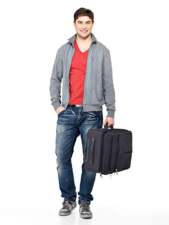 unblemished: Full portrait of smiling happy man with grey suitcase - isolated on white  Stock Photo