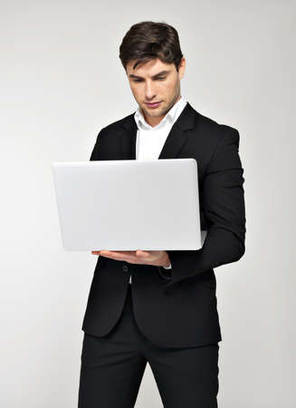 Portrait of  working businessman on laptop and looking in screen  photo