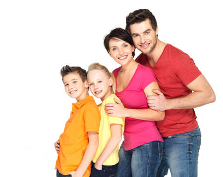 family line: Happy young family with two children standing together in line - isolated on white background