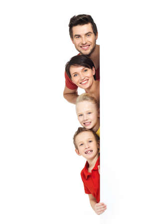 banner stand: Family with a banner smiling - isolated on a white background LANG_EVOIMAGES