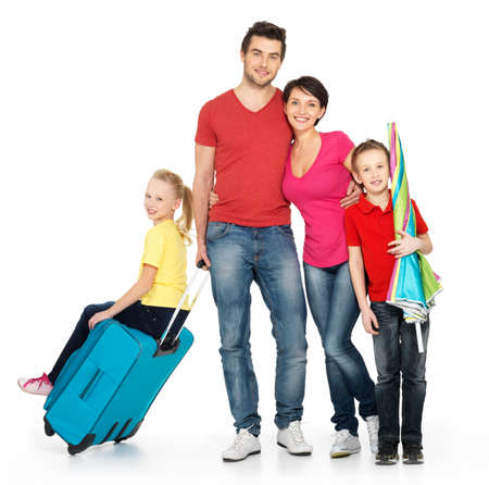 Happy family with  suitcase  at studio isolated on white background Stock Photo - 23190318