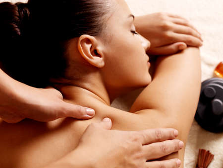 spa therapy: Masseur doing massage on woman body in the spa salon. Beauty treatment concept.