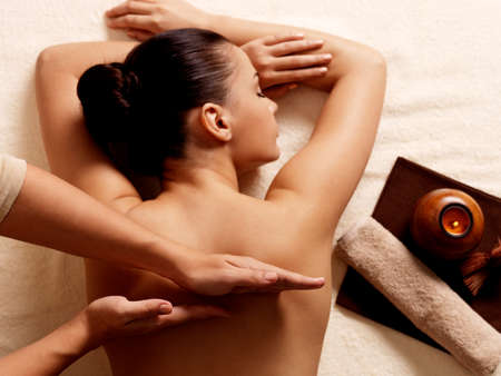 adult massage: Masseur doing massage on woman body in the spa salon. Beauty treatment concept.