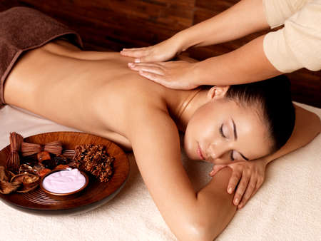 spa: Masseur doing massage on woman body in the spa salon. Beauty treatment concept.