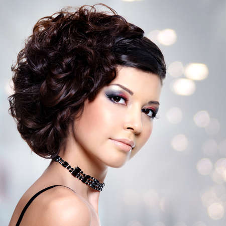 girl short hair: Beautiful young woman with curly hairstyle and bright makeup