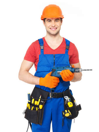 Portrait of smiling handyman with tools isolated on  white background photo