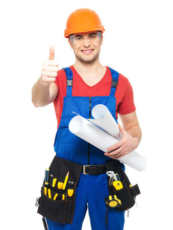 Portrait of smiling handyman with tools and paper showing thumbs up sign   isolated on  white background photo