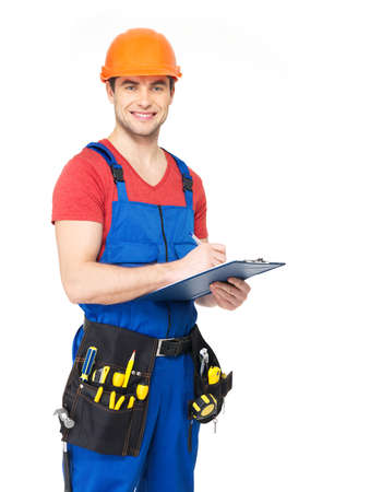 protective workwear: Portrait of smiling worker with tools, planning and writing the note isolated on  white background