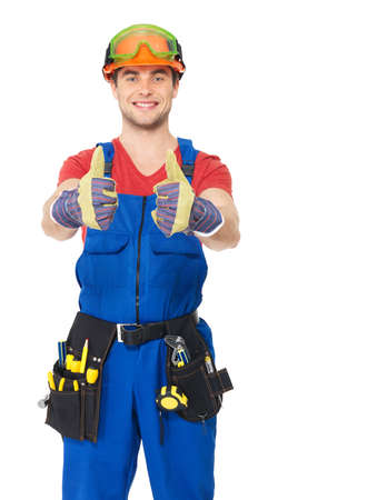 Portrait of happy handyman with tools showing thumbs up sign isolated on  white background