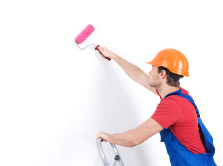 Craftsman painter stands on the stairs with roller,  portrait over white background , rear view Stock Photo - 22587381