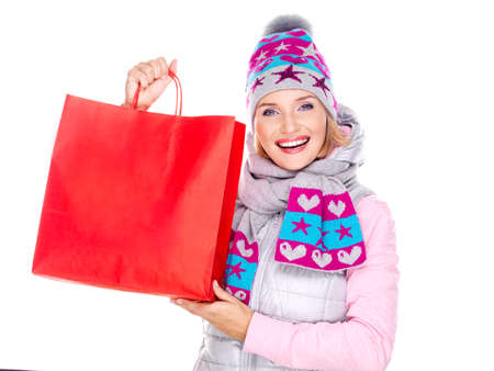 Happy white woman with gifts after shopping to the new year photo