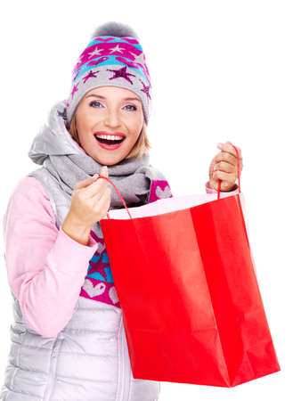 Happy smiling woman with gifts after shopping to the new year - isolated on white photo