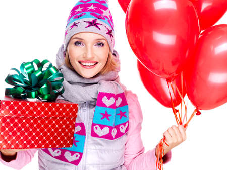 Closeup portrait of the fun happy adult woman with red gift box and balloons looking at camera -  isolated on white background  photo