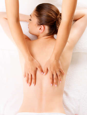 Massage therapy: Woman having massage of body in the spa salon. Beauty treatment concept.
