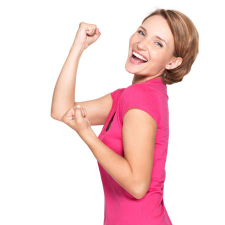Beautiful happy woman celebrating success  being a winner with икшпре expression - isolated on white background photo