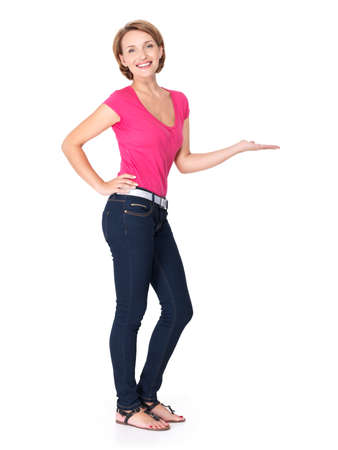Full portrait of adult happy woman with presentation gesture over white background photo