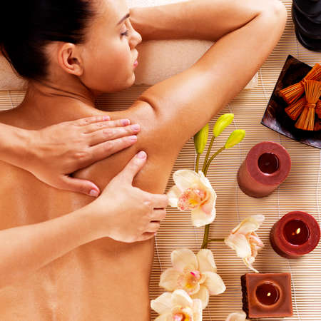 spa therapy: Adult woman in spa salon having body relaxing massage.