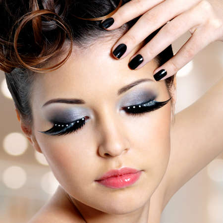 Portrait of the glamour woman with black nails and   fashion eye makeup   photo
