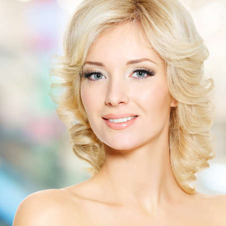 Clouseup face of beautiful woman with white hairs over art background photo